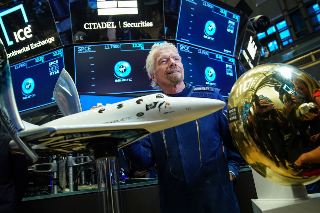 Sir Richard Branson, Founder of Virgin Galactic, poses for photographs before ringing a ceremonial bell on the floor of the New York Stock Exchange (NYSE) to promote the first day of trading of Virgin Galactic Holdings shares on October 28, 2019 in New York City. Virgin Galactic Holdings became the first space-tourism company to go public as it began trading on Monday with a market value of about $1 billion.