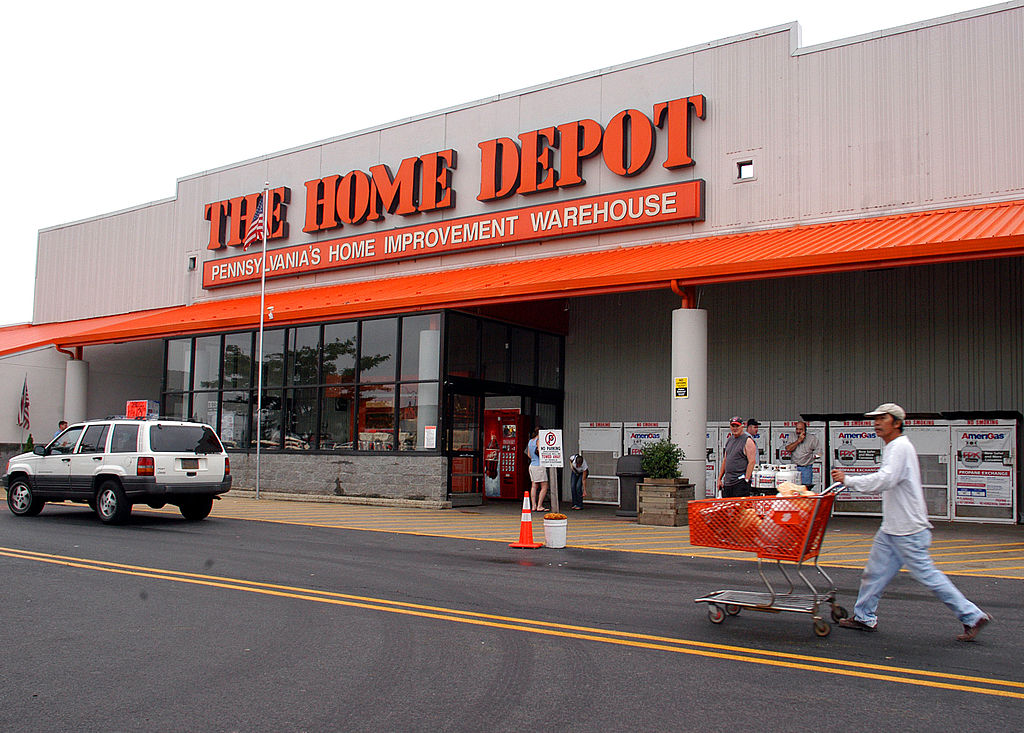A customer pushes a cart after making a purchase at a Home Depot store July 10, 2003 in Philadelphia. U.S. Energy Secretary Spencer Abraham had just visited the Philadelphia Home Depot on a nationwide Smart Energy Tour, discussing the needs for homeowners, consumers, and businesses to be more energy efficient. (
