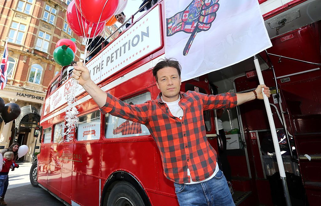 LONDON, ENGLAND - MAY 15: Jamie Oliver attends a photocall during activities on Food Revolution Day in Leicester Square on May 15, 2015 in London, England.