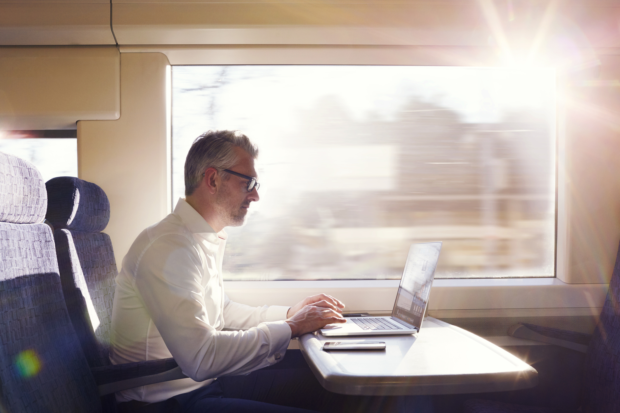 Businessman working on a commuter train.