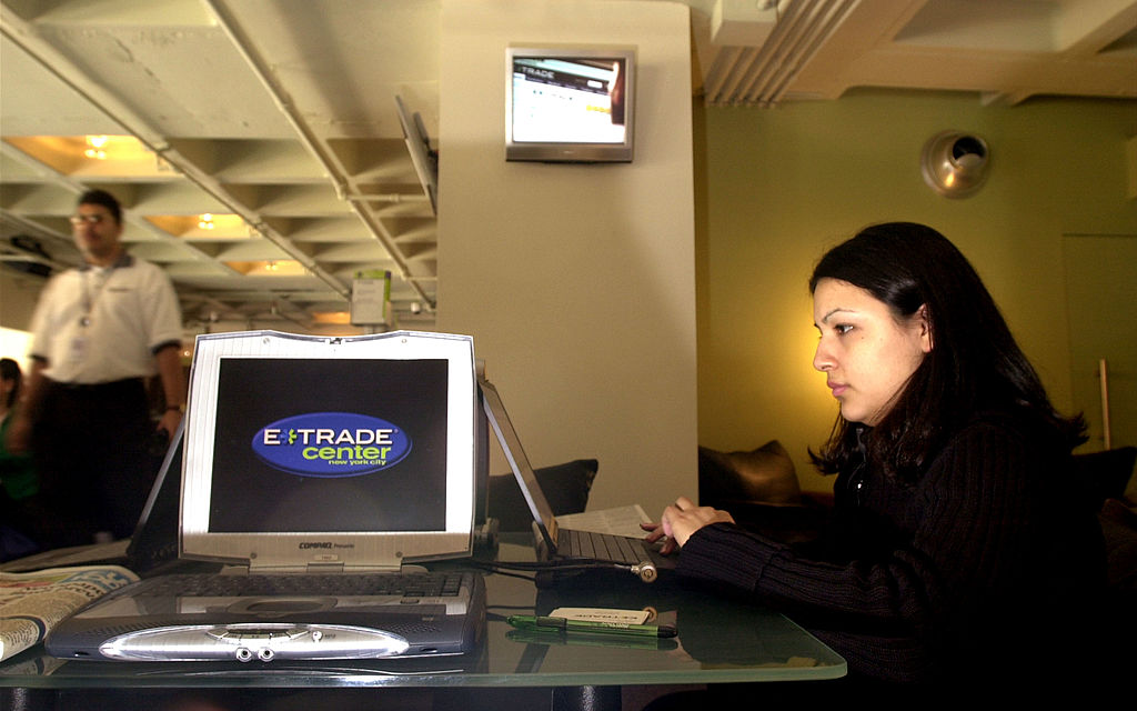A customer checks her stocks on the floor of the new E*Trade Center April 4, 2001 in New York. The E*Trade Center is a state-of-the-art online trading facility that features three floors of terminals, a coffee shop, and a video learning center.
