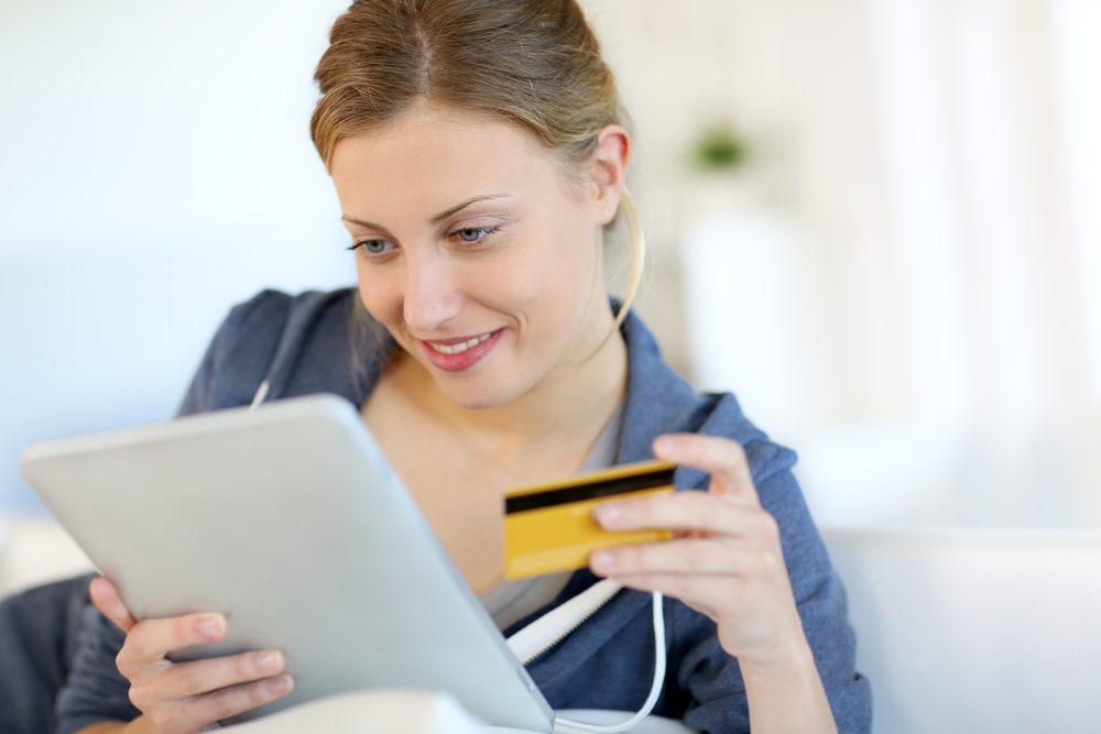 woman with credit card about to make online purchase