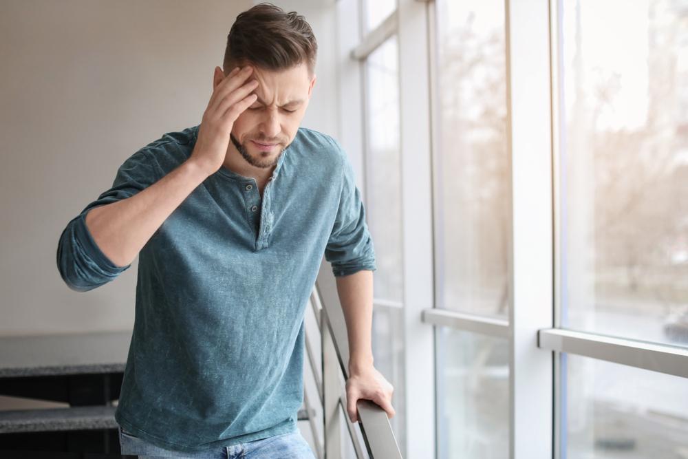 man going downstairs has a headache