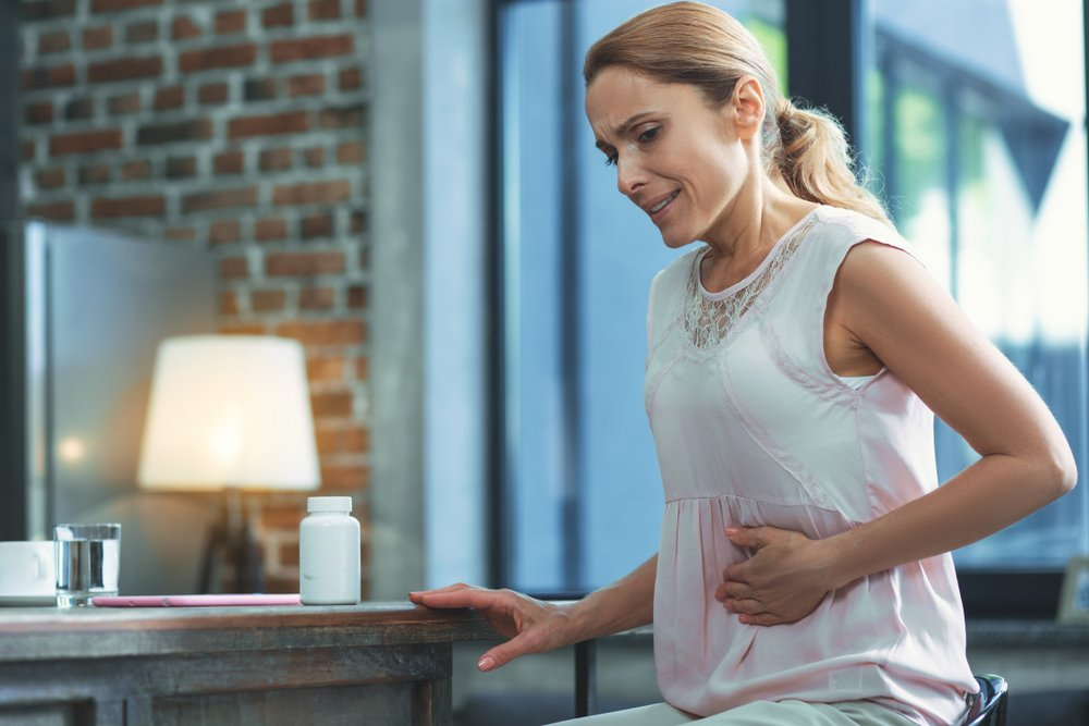 woman having stomach pain digestive issues