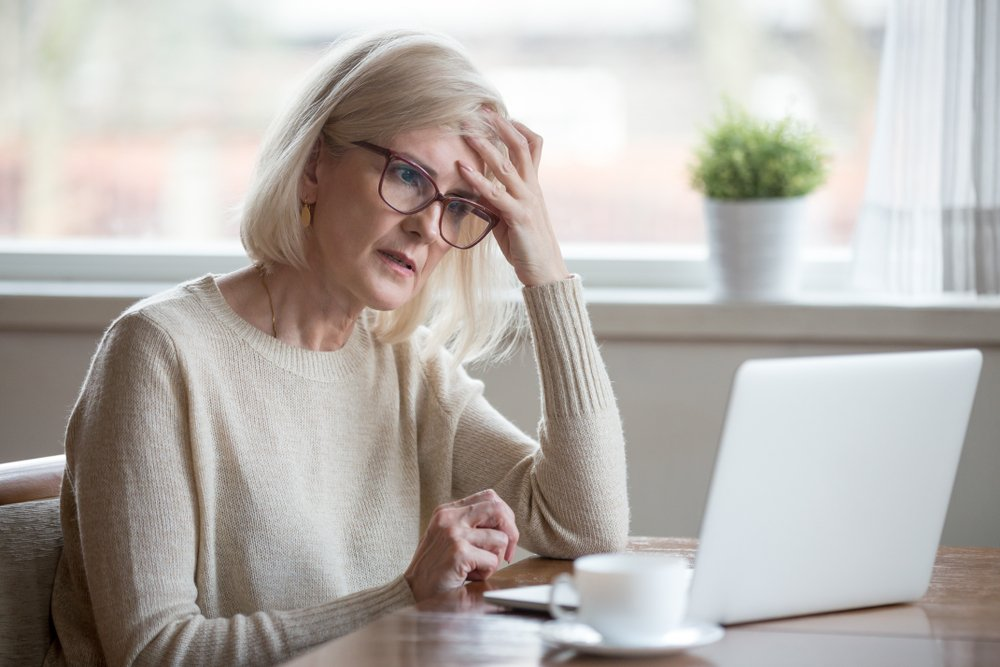 older woman looking confused at computer