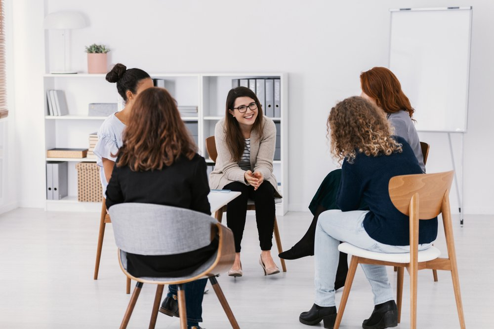 women's therapy group sitting together