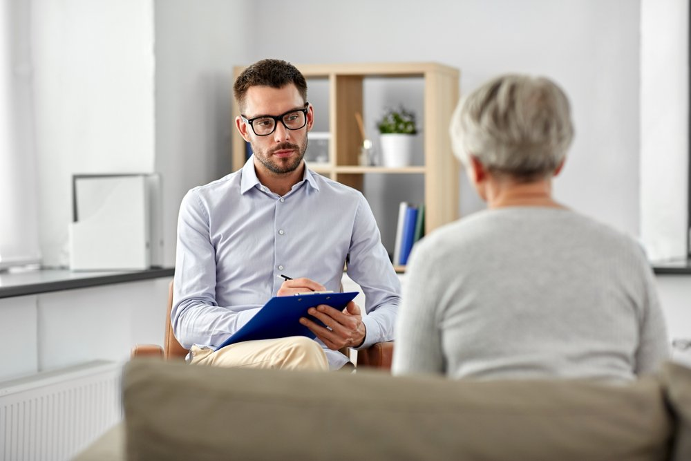psychiatrist speaking with a patient