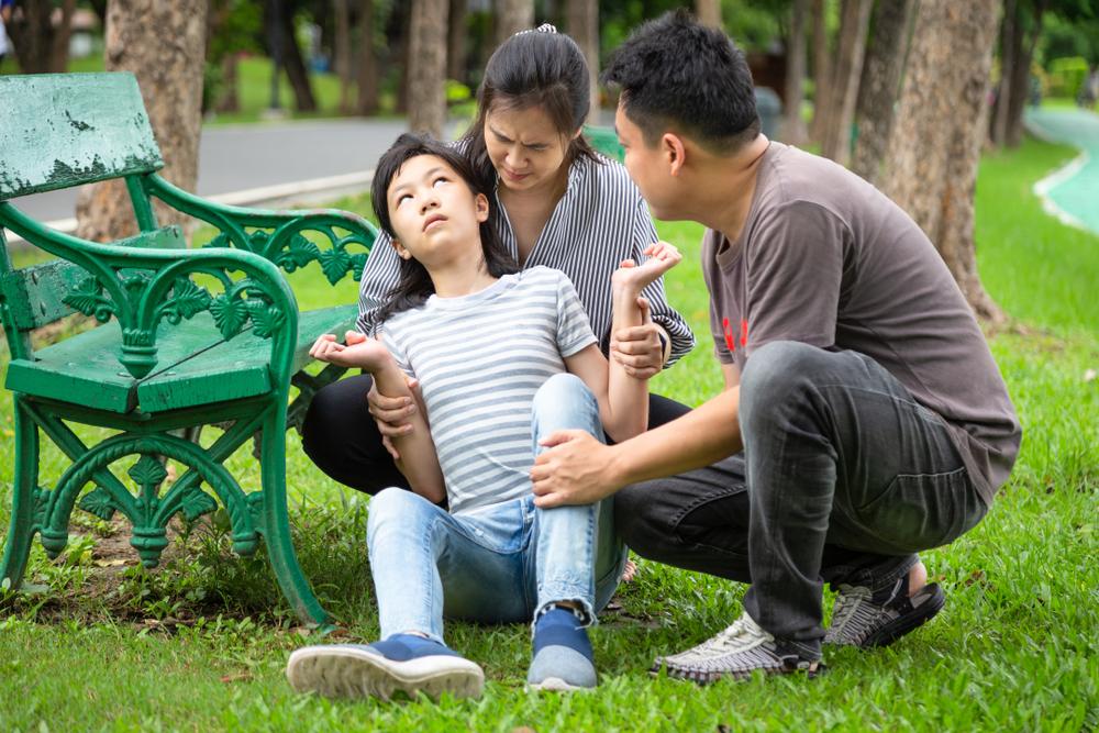 little girl having a seizure in the park