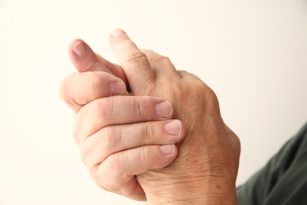 man with pain in his hand, pinky finger