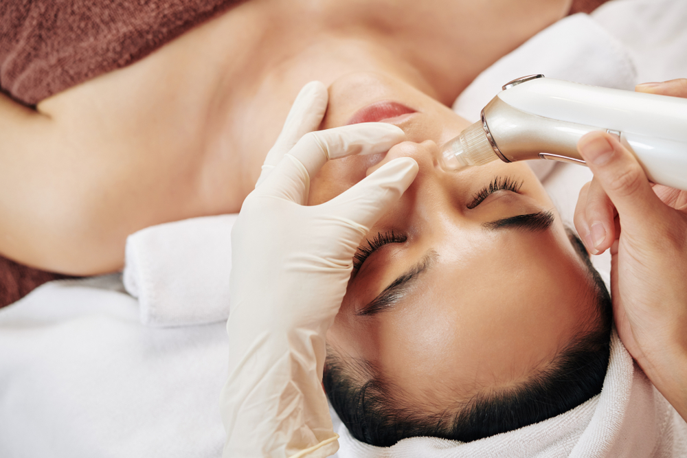 woman having her pores vacuumed at a spa