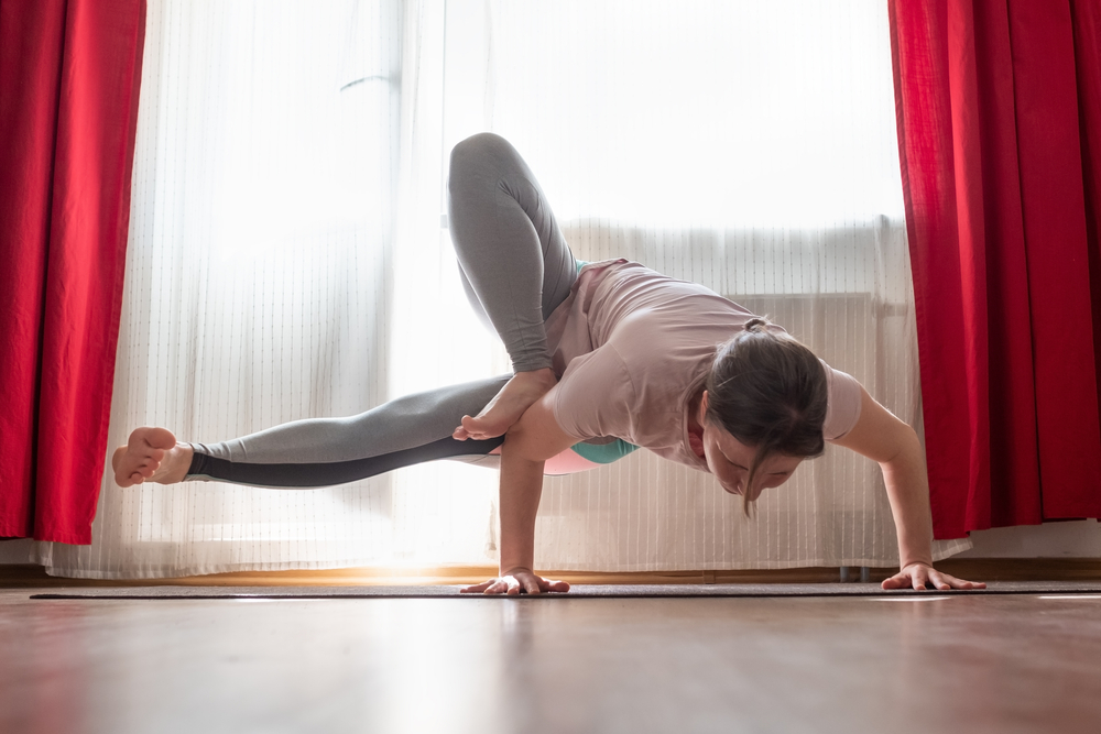 woman doing wrist extension handstand yoga pose