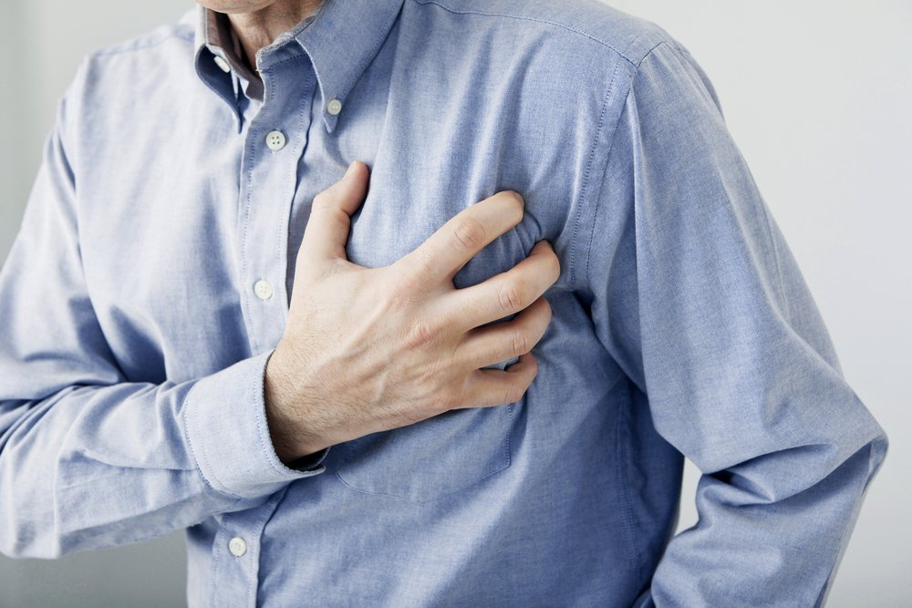man clutching his chest, heart attack concept