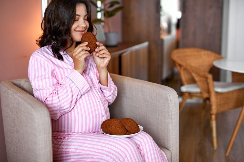 pregnant woman smelling fresh baked cookies