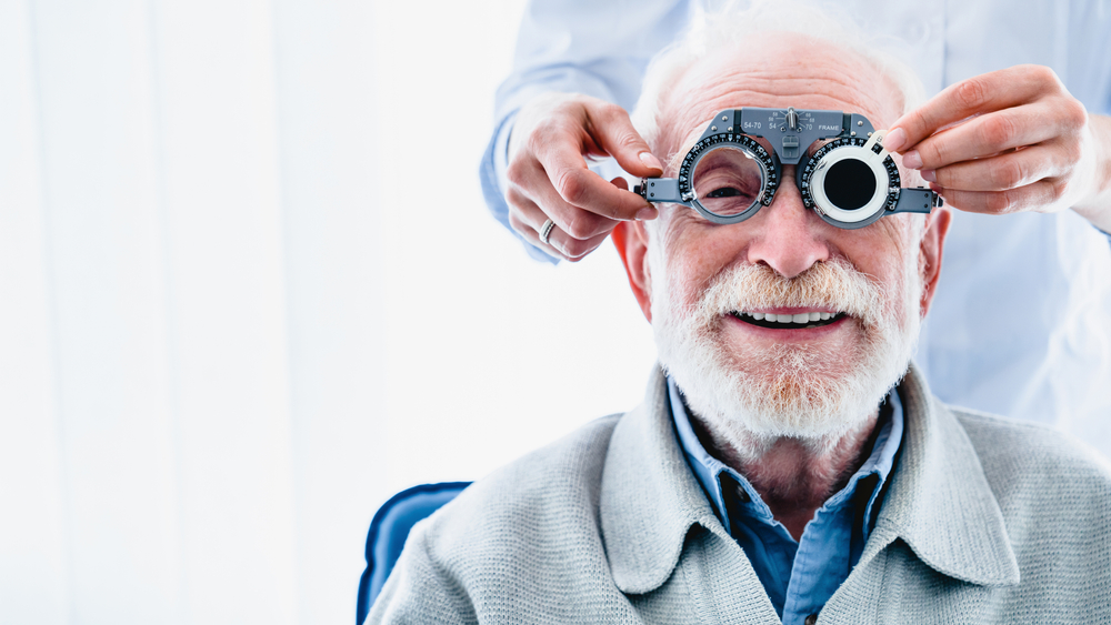 smiling old man having his eyesight checked
