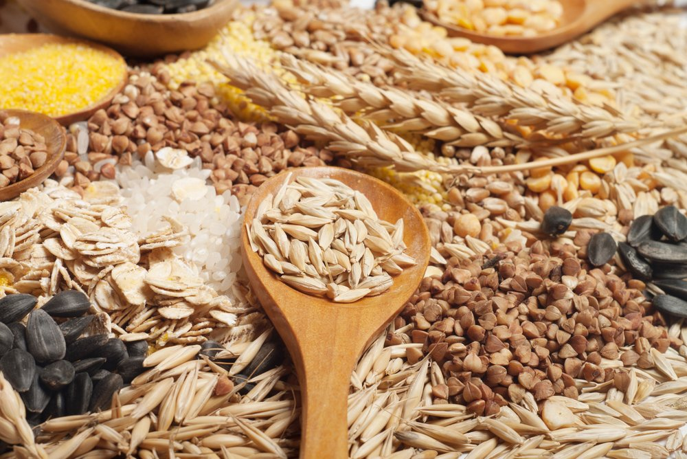 cereal grains with a wooden spoon