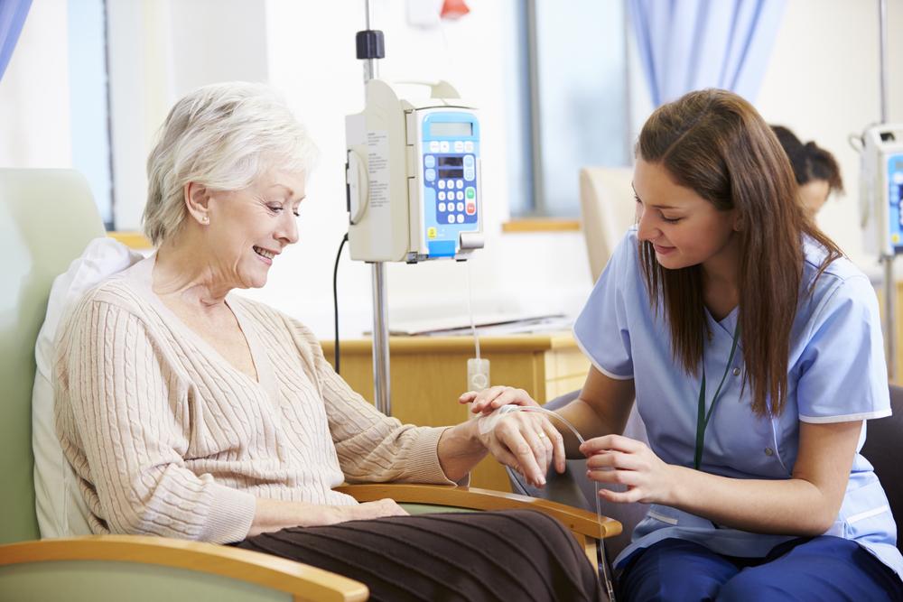 nurse helping woman getting chemotherapy