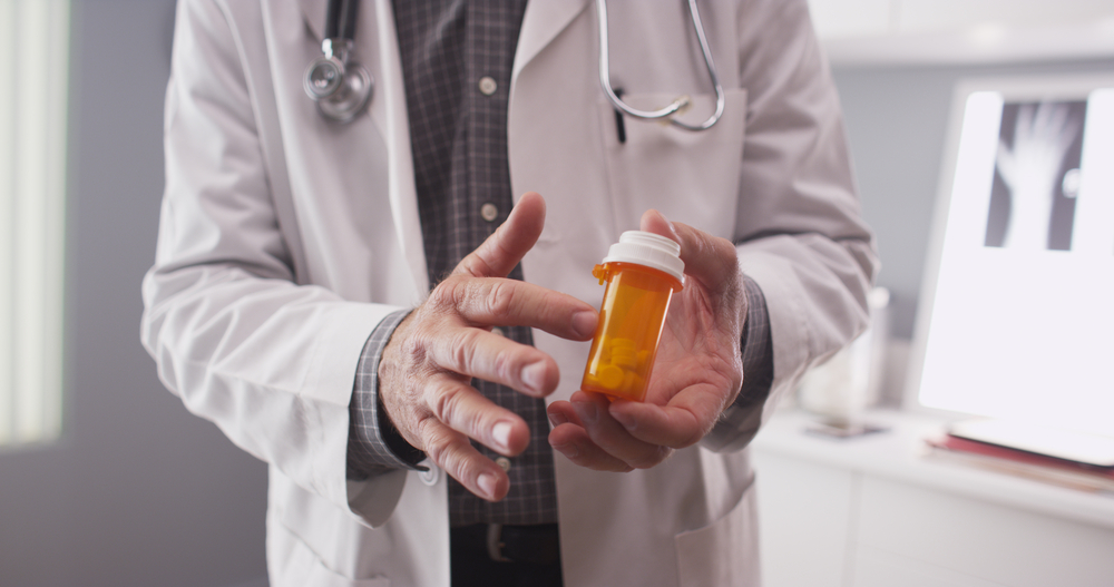doctor indicating prescription medication for patient