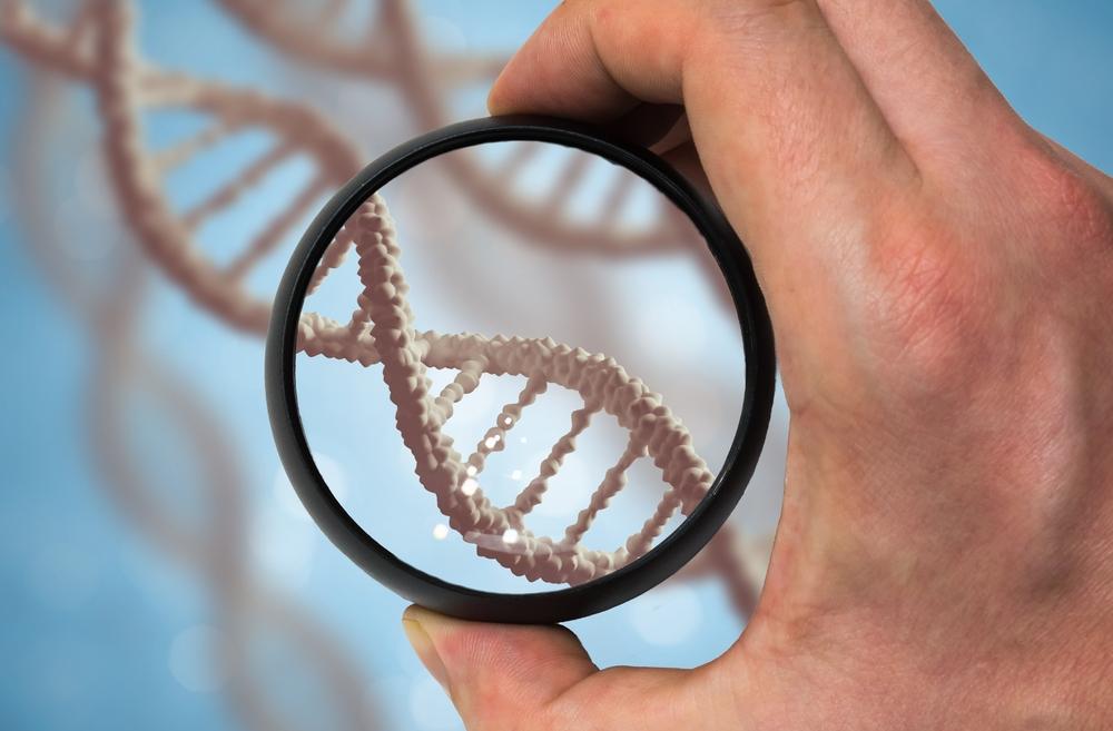 digital illustration of magnifying glass over strand of DNA