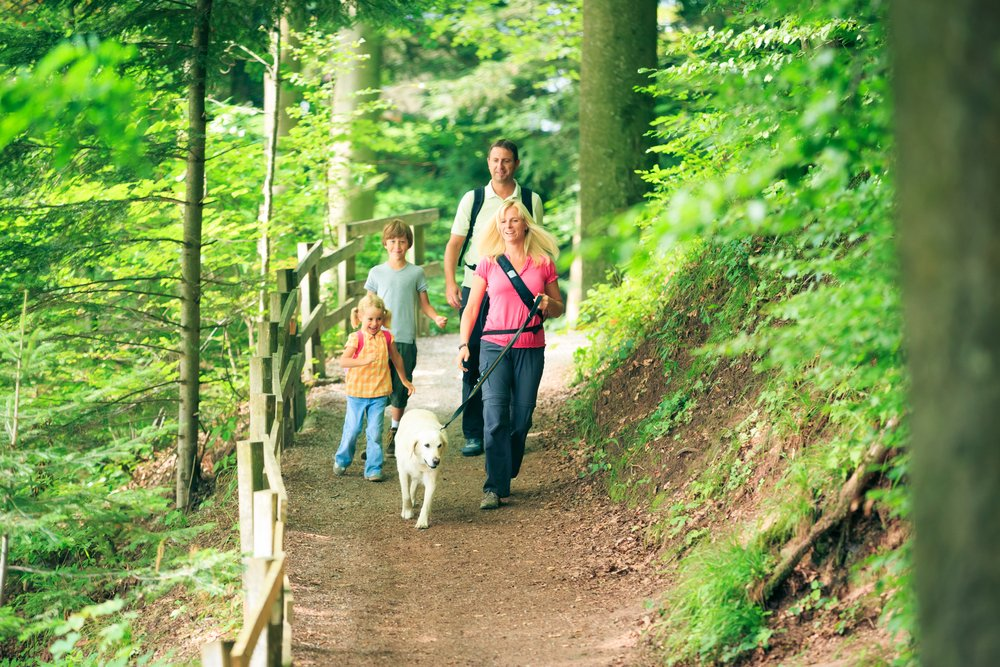 family hiking with dog