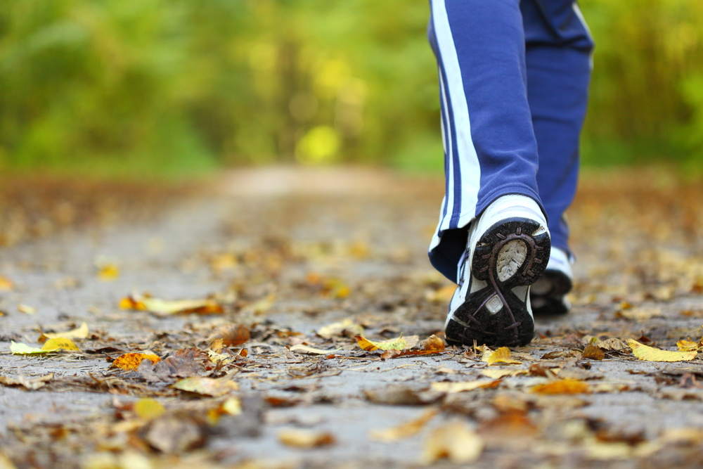 cropped image of a person in running shoes walking