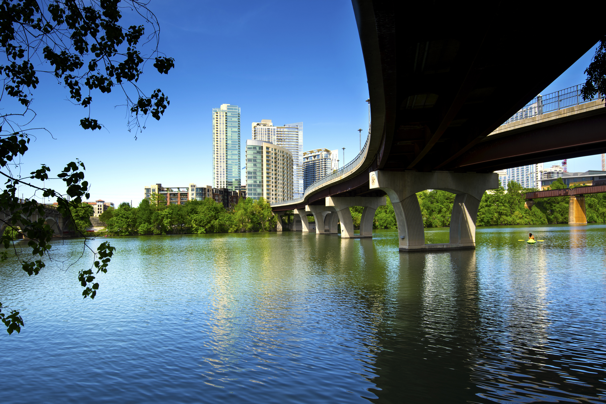 The James D. Pfluger Pedestrian and Bicycle Bridge crosses Lady Bird Lake in downtown Austin, Texas. The bridge connects the north and south side of the Lady Bird Hike and Bike Trail.