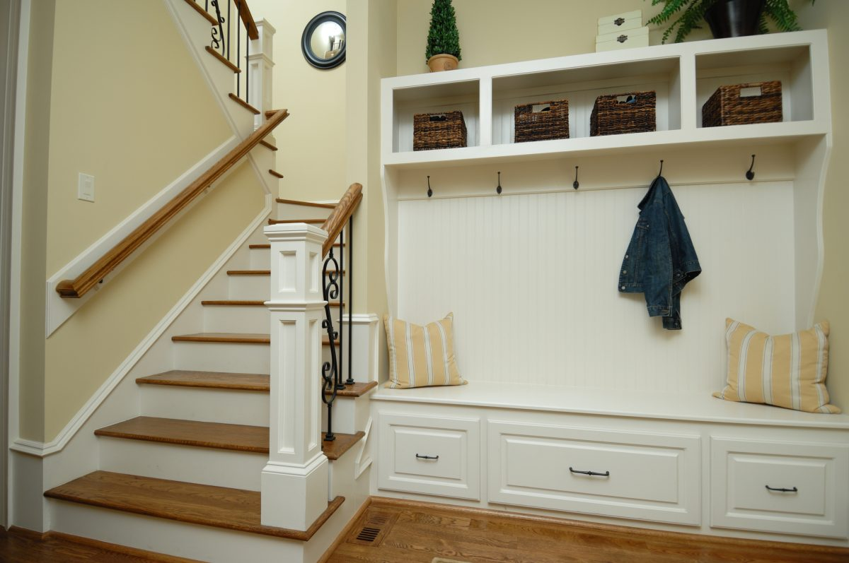 Large wall shelving organizers and seating combos are the height of entryway luxury.