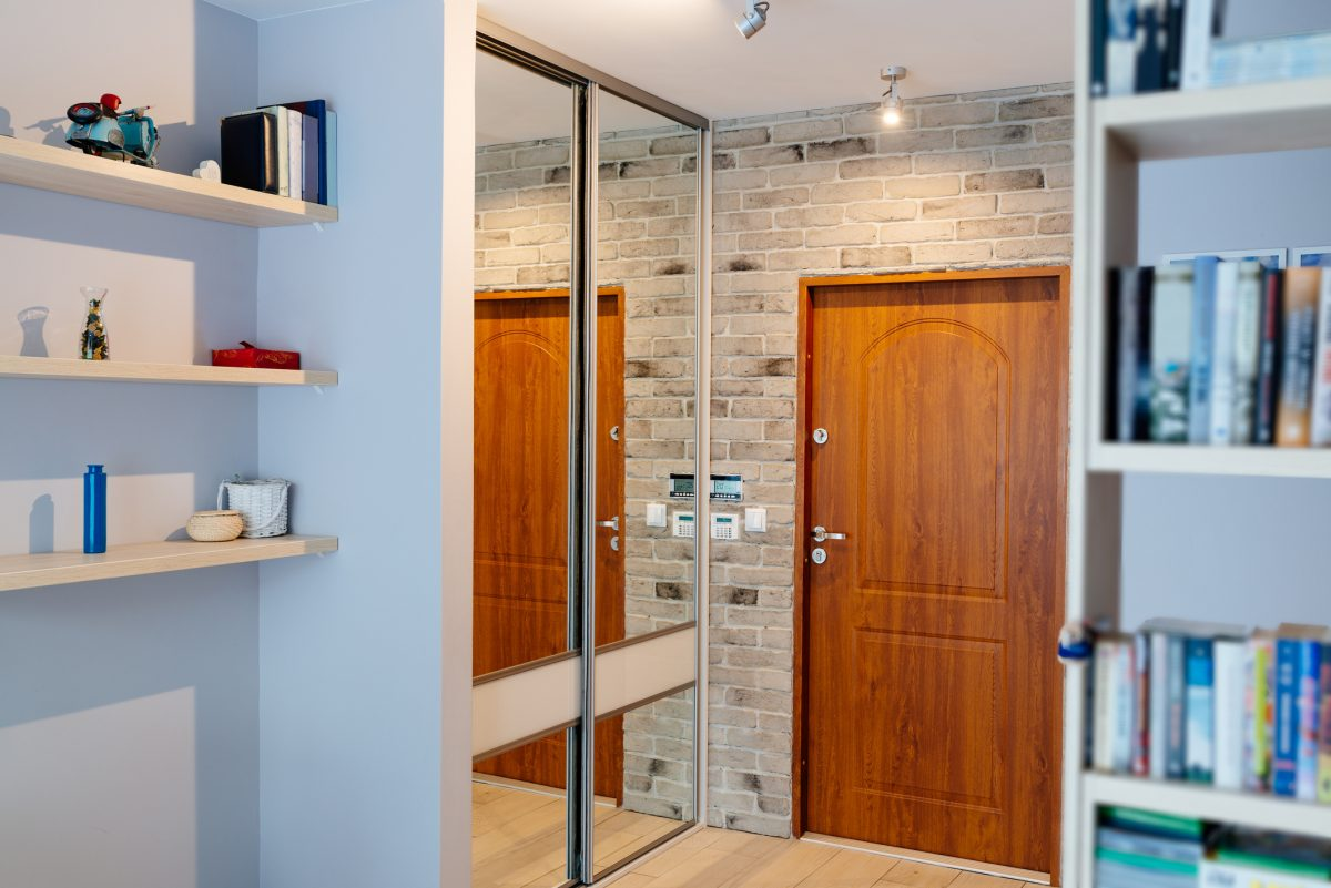 Mirrored entryway closet doors are an interesting use of limited space.