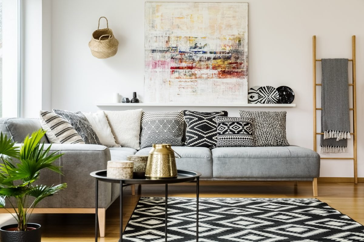 The geometric patterns spread throughout this living room give the monochrome color palette fascinating layers.