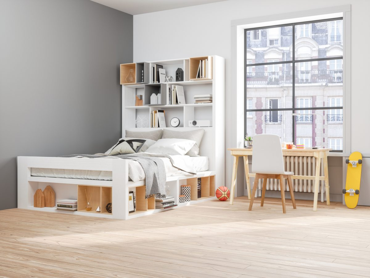 A bed shouldered by a shelf