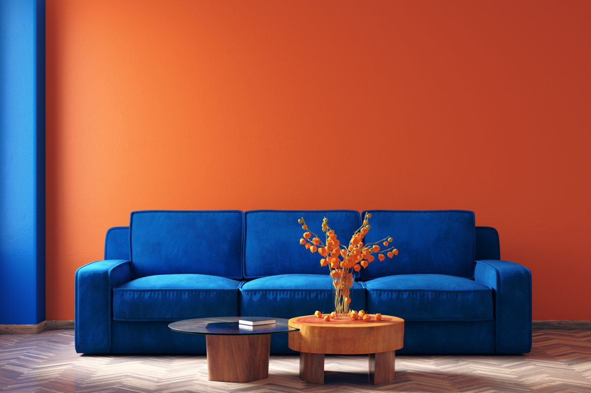 Classic Blue furniture pops against an orange wall.