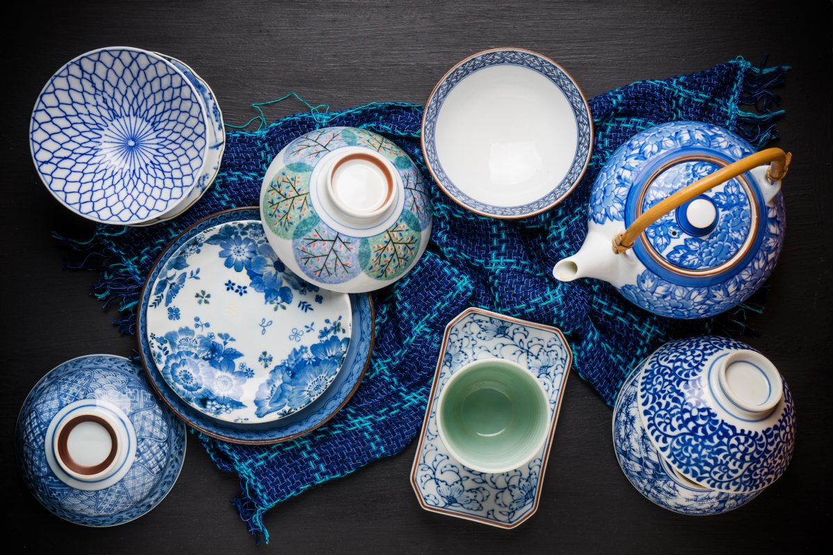 Classic Blue linens and dishware add a pop of color to an otherwise neutral space.