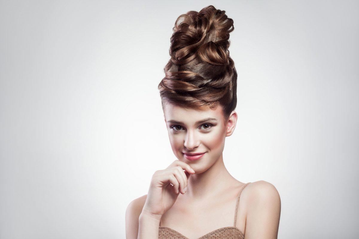 A stunning Dutch braided bun perched high on your head creates a striking image.