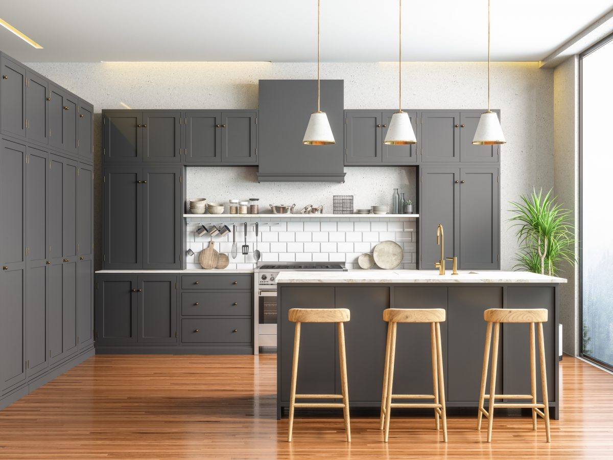 Grey cabinets look warm with natural wood flooring and furniture.
