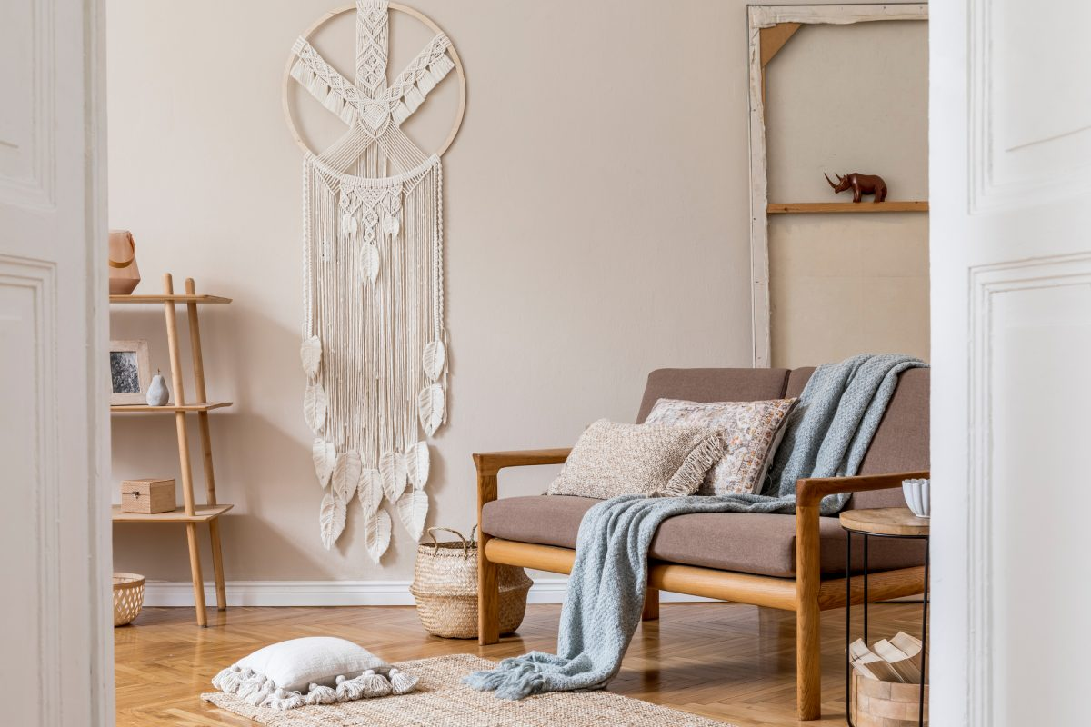 A large macramé dreamcatcher hanging on a living room wall