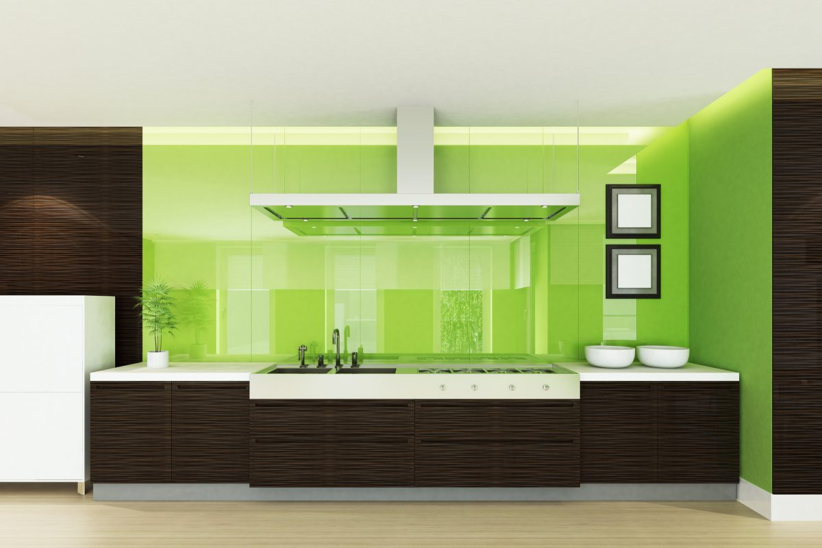 Bright green walls pair well with textured chocolate brown cabinetry.