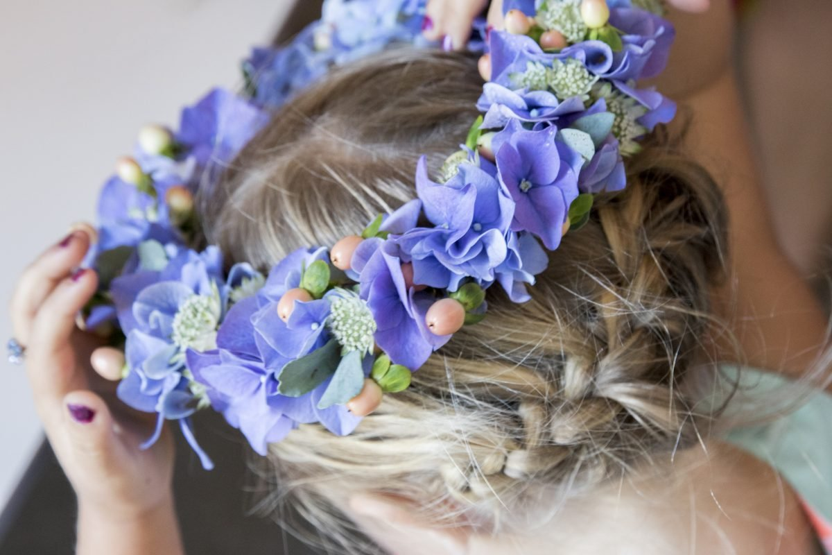 Young girl with crown braid and flowers in her hair