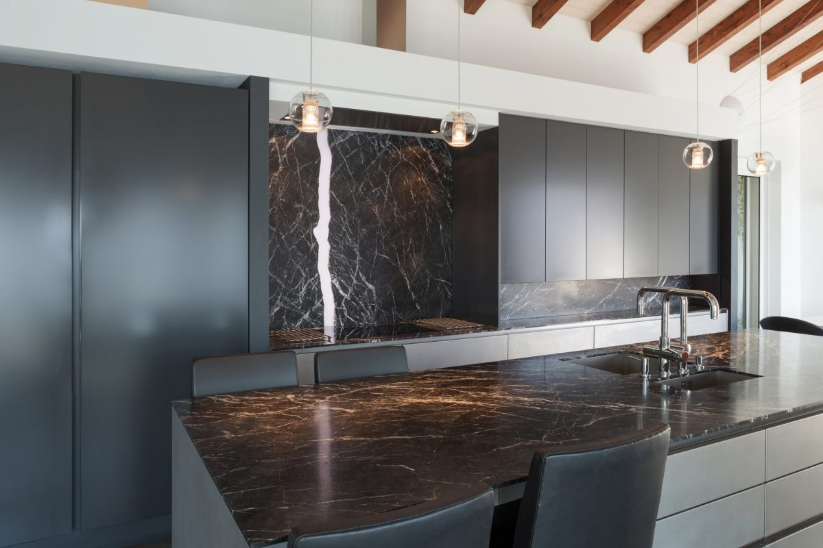 Natural patterns in this black countertop add visual interest.