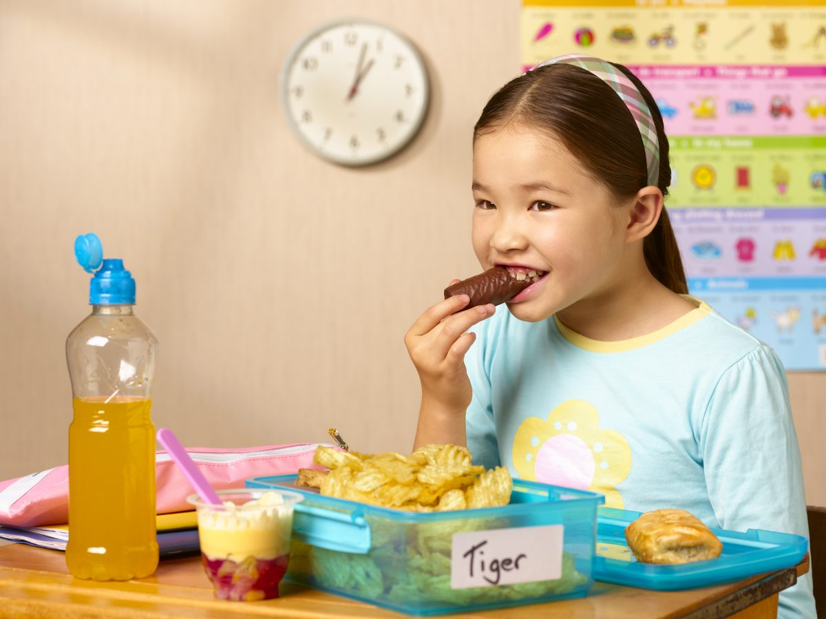 Young girl eating with hairband in her hair