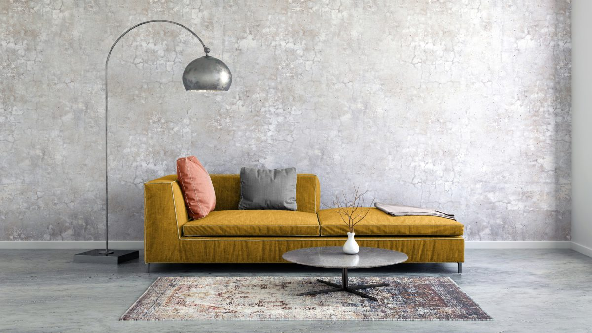 Living room with grey walls and mustard sofa