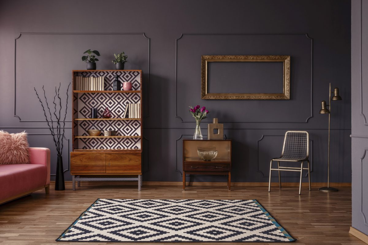 Deep purple living room with wooden furniture