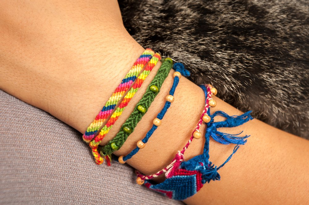 Closeup of a colorful friendship bracelet on a child's hand